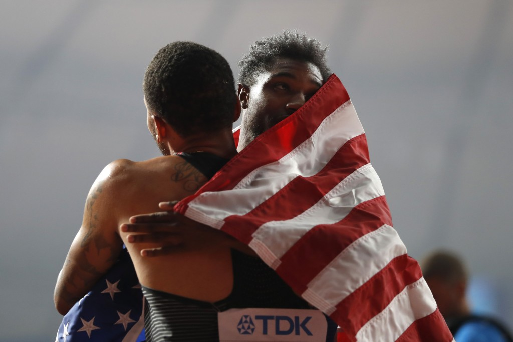 Noah Lyles of the U.S., gold medalist, right, celebrates with Andre de Grasse of Canada, silver medalist, after the men's 200 meter final at the World...