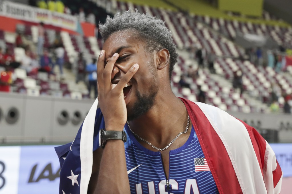 Noah Lyles, of the United States, celebrates after winning the men's 200 meters at the World Athletics Championships in Doha, Qatar, Tuesday, Oct. 1, ...