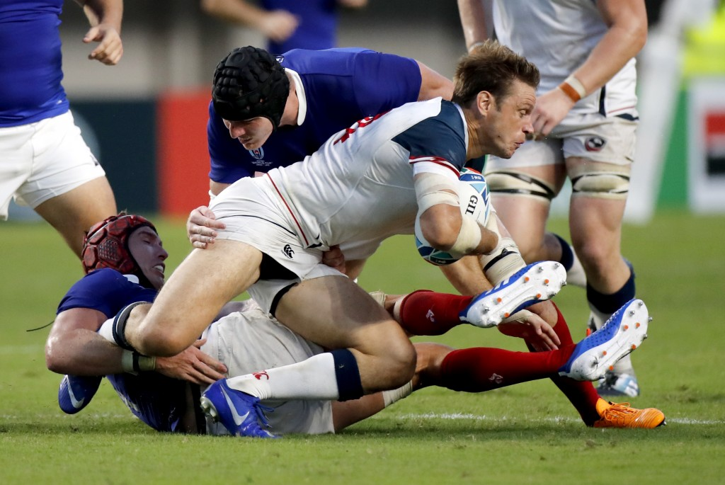 United States' Blaine Scully runs at the French defence during the Rugby World Cup Pool C game at Fukuoka Hakatanomori Stadium between France and the ...