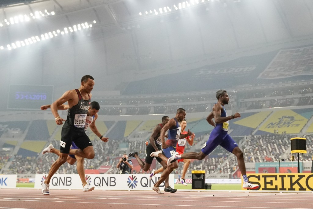 Noah Lyles, right, of the United States, wins the men's 200 meters at the World Athletics Championships in Doha, Qatar, Tuesday, Oct. 1, 2019. (AP Pho...