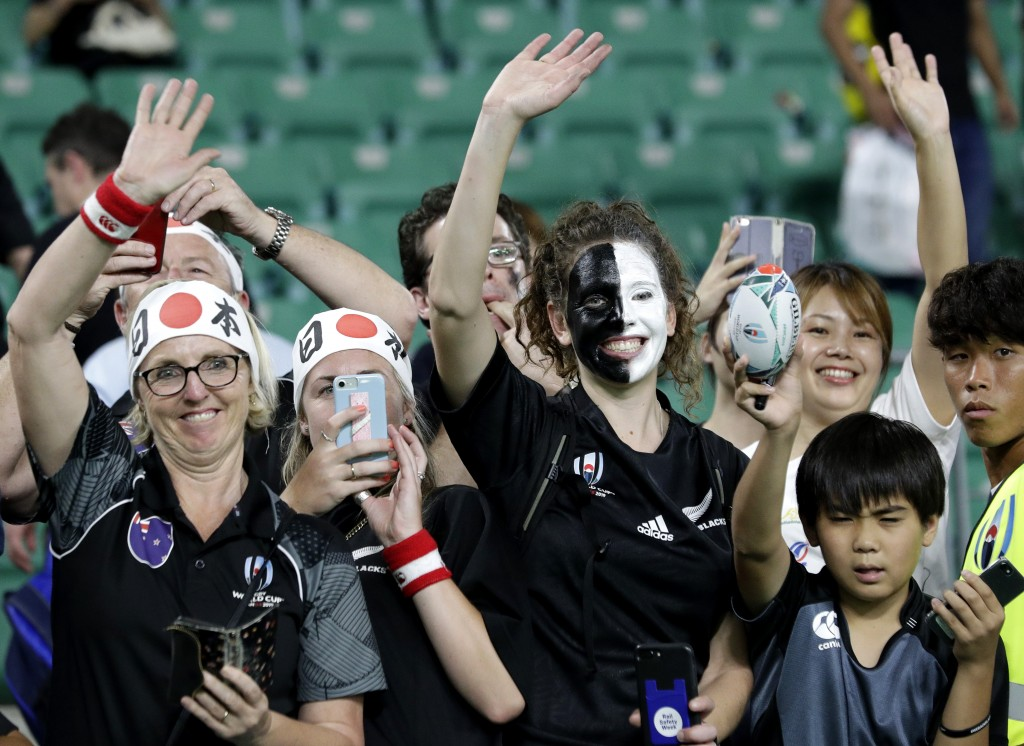 New Zealand supporters wave to the All Blacks following their Rugby World Cup Pool B game at Oita Stadium between New Zealand and Canada in Oita, Japa