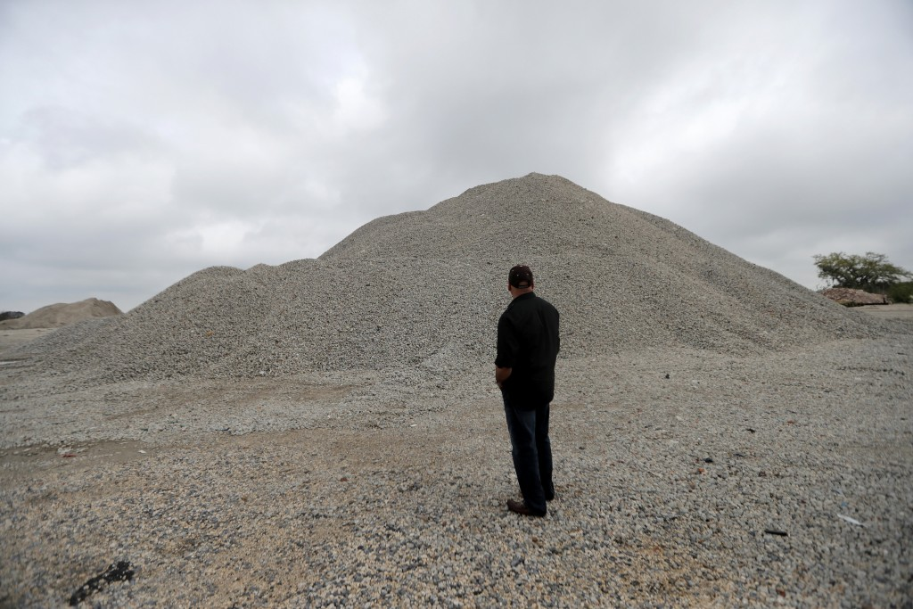 In this March 11, 2019, photo, George Ricks, president of the Save Louisiana Coalition, stands in front of material from the foundation of oyster beds...
