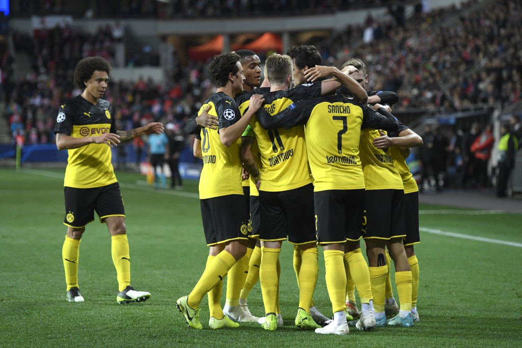 Borussia Dortmund's players celebrate their first goal during the Champions League group F soccer match between Slavia Prague and Borussia Dortmund in...