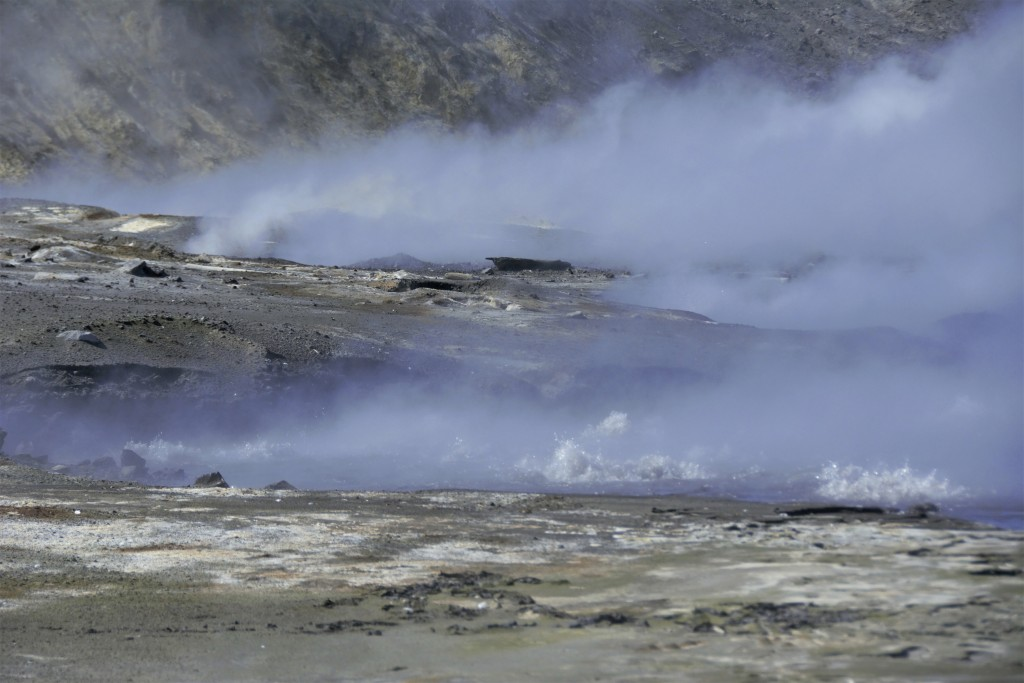 This August 2019 photo released by the National Oceanic and Atmospheric Administration Fisheries (NOAA) shows steam from volcanic vents rising on Bogo...