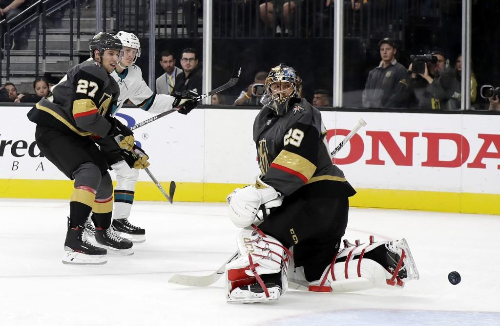 Vegas Golden Knights goaltender Marc-Andre Fleury (29) watches after a goal from San Jose Sharks left wing Marcus Sorensen, left, as defenseman Shea T...