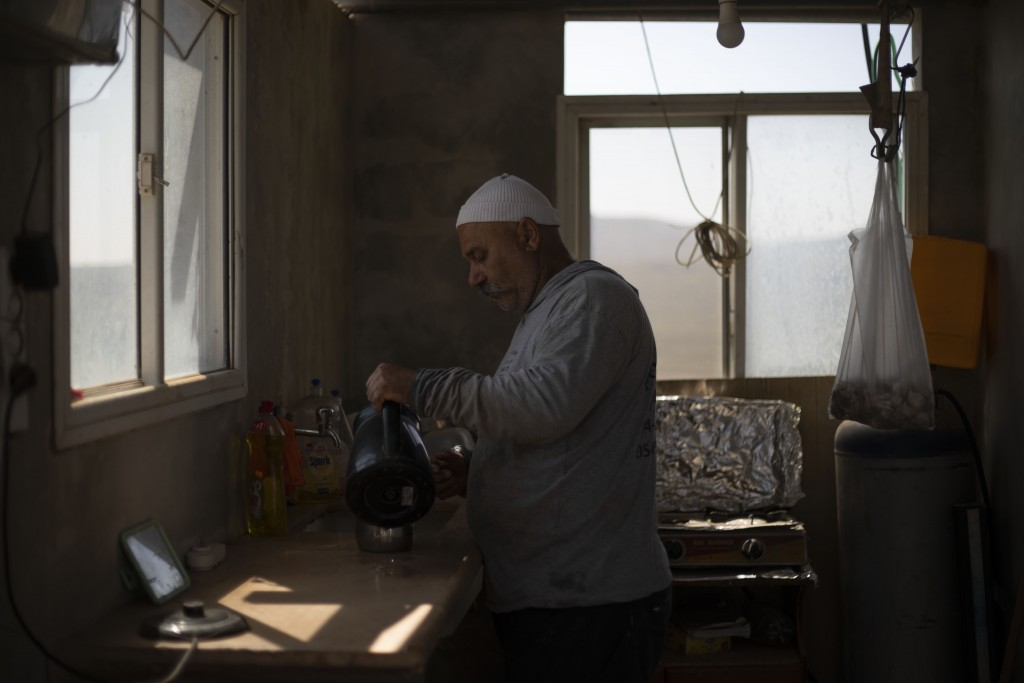 In this Sept. 10 2019 photo, Druze farmer Noraldeen Masoud makes coffee on his farmland in the Israeli-controlled Golan Heights, near the border with ...