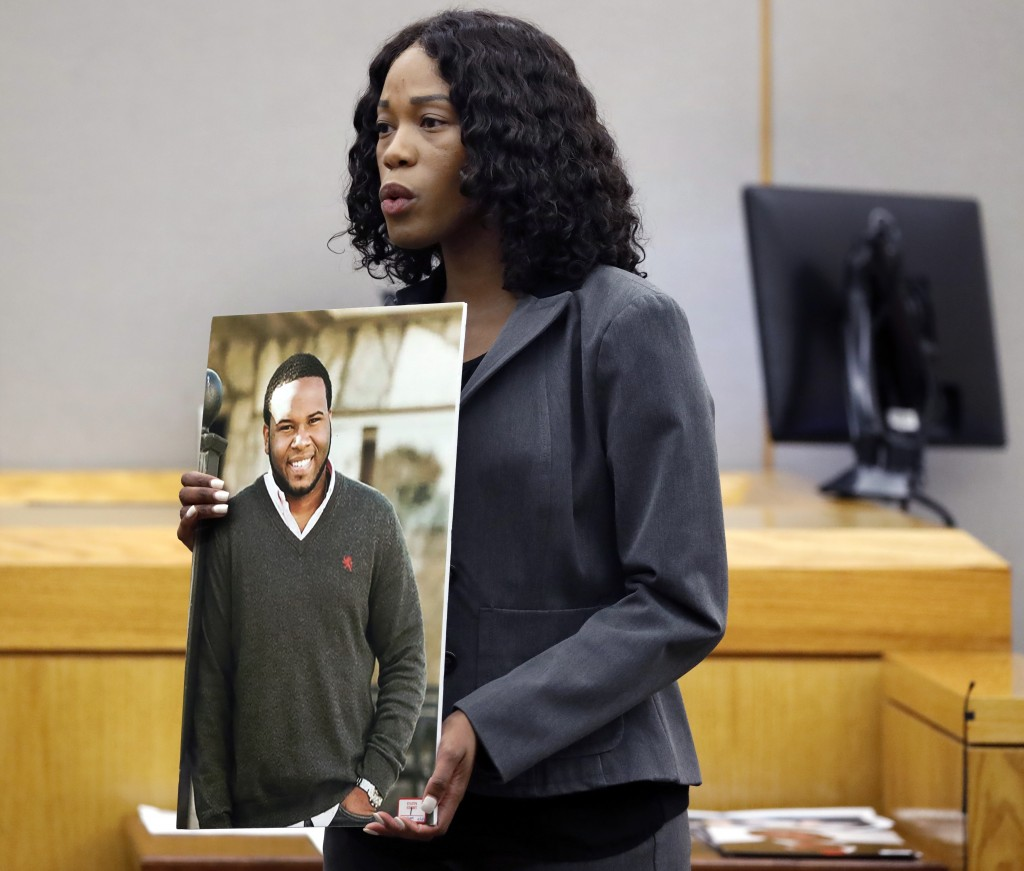 Assistant District Attorney Mischeka Nicholson shows the jury a photo of victim Botham Jean during closing remarks in the sentencing phase of former D