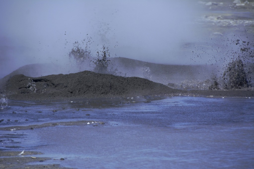 This August 2019 photo released by the National Oceanic and Atmospheric Administration Fisheries (NOAA) shows mud shooting upward from the openings ne