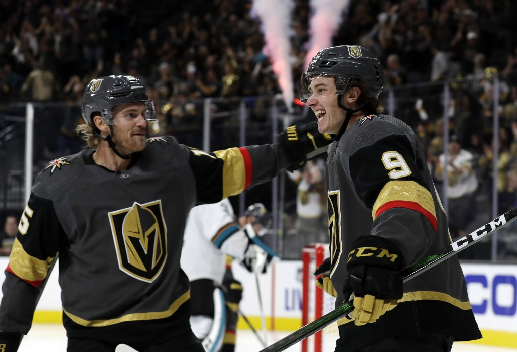 Vegas Golden Knights defenseman Jon Merrill, left, congratulates center Cody Glass after he scored against the San Jose Sharks during the second perio...