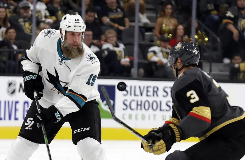 Vegas Golden Knights defenseman Brayden McNabb (3) covers a pass from San Jose Sharks center Joe Thornton during the first period of an NHL hockey gam...