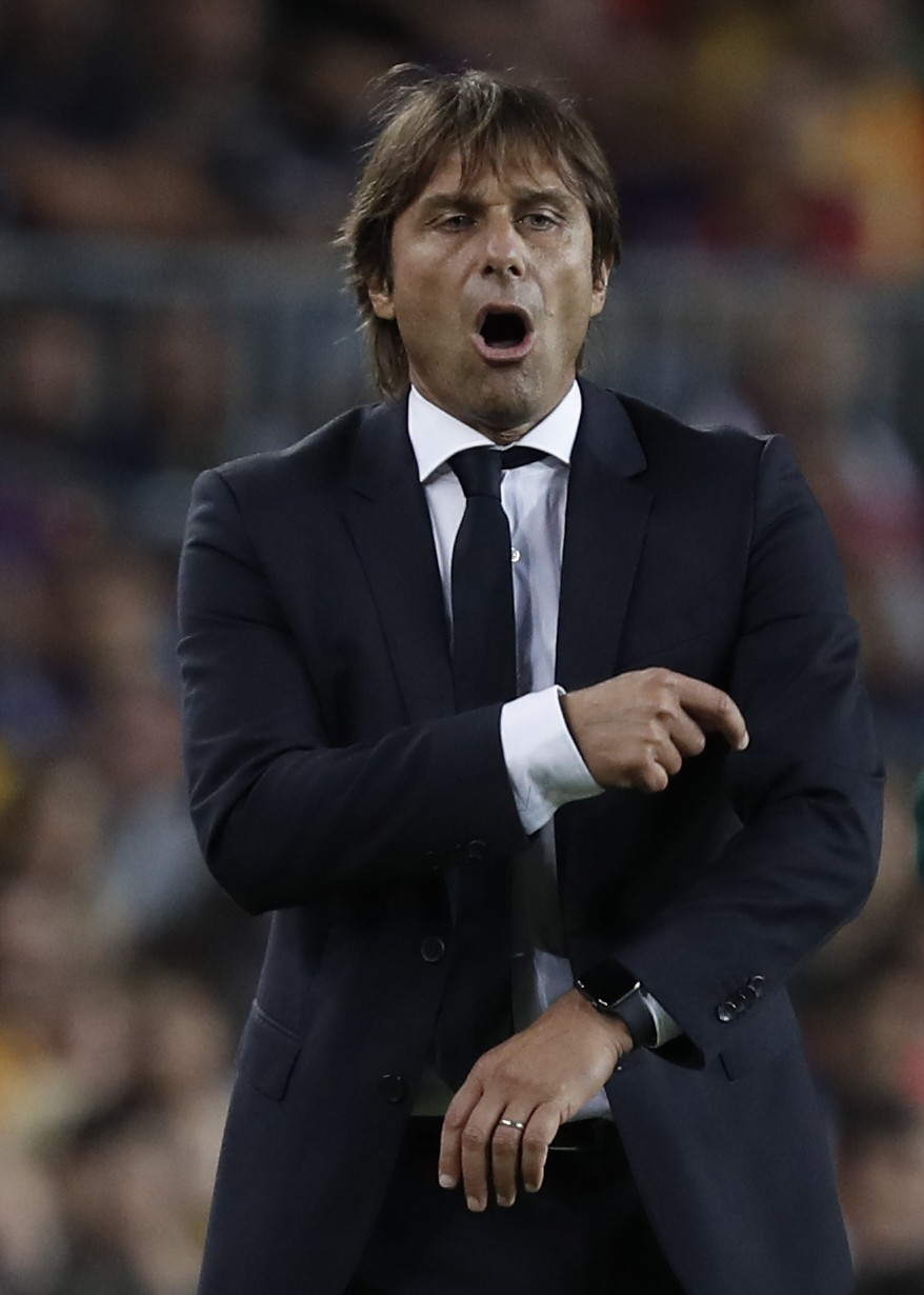 Inter Milan's head coach Antonio Conte complains during a group F Champions League soccer match between F.C. Barcelona and Inter Milan at the Camp Nou