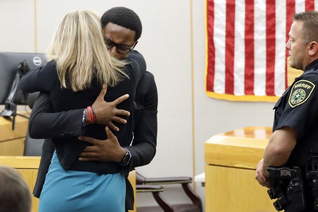 Botham Jean's younger brother Brandt Jean hugs convicted murderer and former Dallas Police Officer Amber Guyger after delivering his impact statement ...