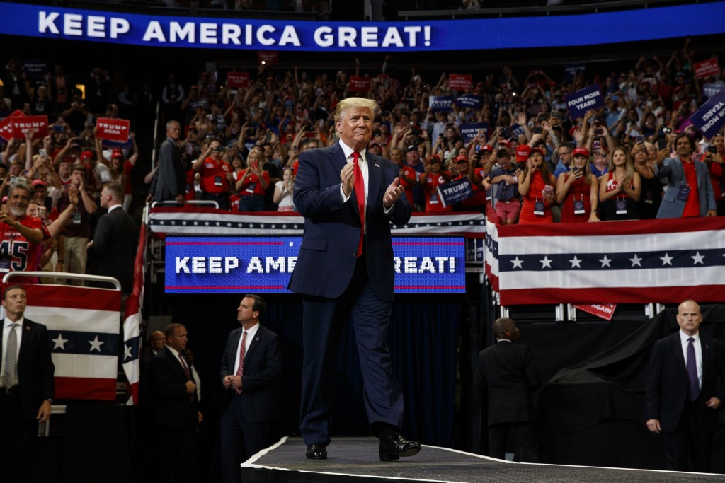 HOLD FOR STORY FILE - In this June 18, 2019, file photo, President Donald Trump arrives to speak at his re-election kickoff rally at the Amway Center,...