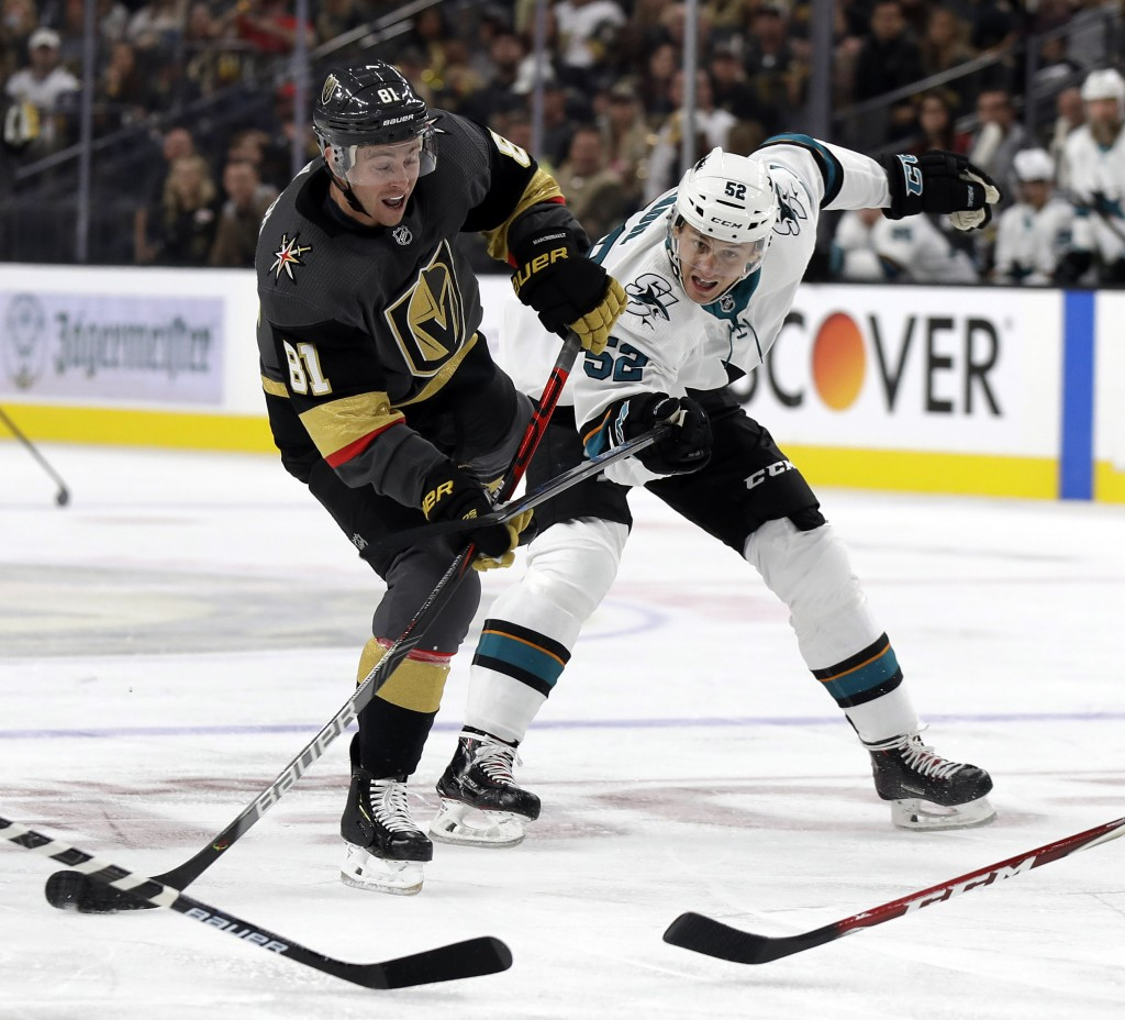 Vegas Golden Knights center Jonathan Marchessault shoots as San Jose Sharks center Lukas Radil defends during the second period of an NHL hockey game ...