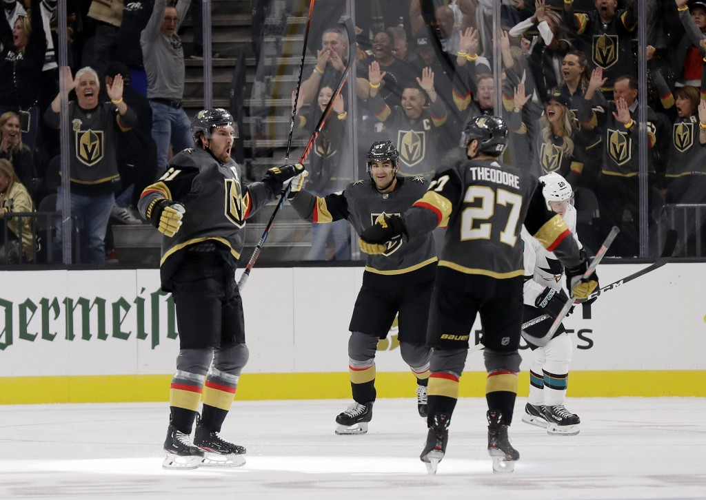 Vegas Golden Knights right wing Mark Stone, left, celebrates after scoring against the San Jose Sharks during the first period of an NHL hockey game W...