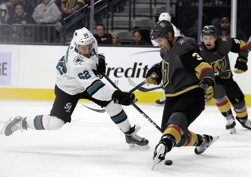 San Jose Sharks right wing Kevin Labanc shoots under Vegas Golden Knights defenseman Brayden McNabb during the first period of an NHL hockey game Wedn...
