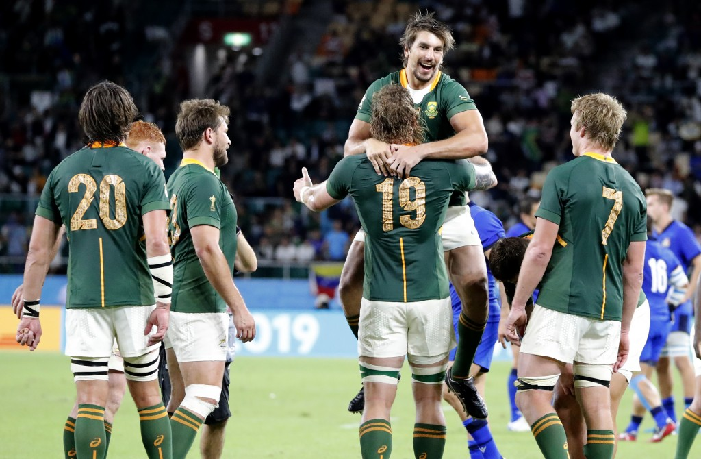 South Africa's Eben Etzebeth celebrates with teammate RG Snyman following their Rugby World Cup Pool B game at Shizuoka Stadium Ecopa against Italy in...