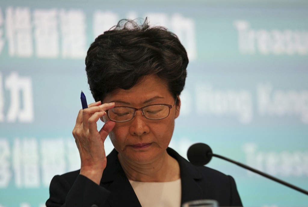 Hong Kong Chief Executive Carrie Lam attends a press conference in Hong Kong Friday, Oct. 4, 2019. Lam has banned protesters from wearing masks to con...