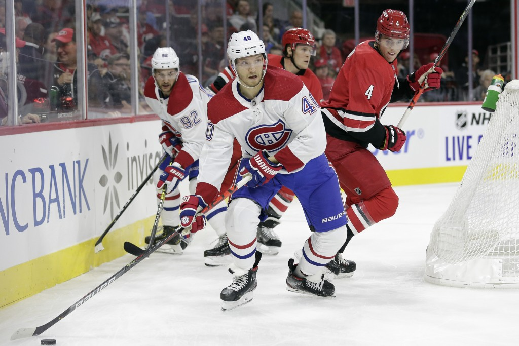 Montreal Canadiens right wing Joel Armia (40), of Finland, controls the puck while Carolina Hurricanes defenseman Haydn Fleury (4) defends during the ...