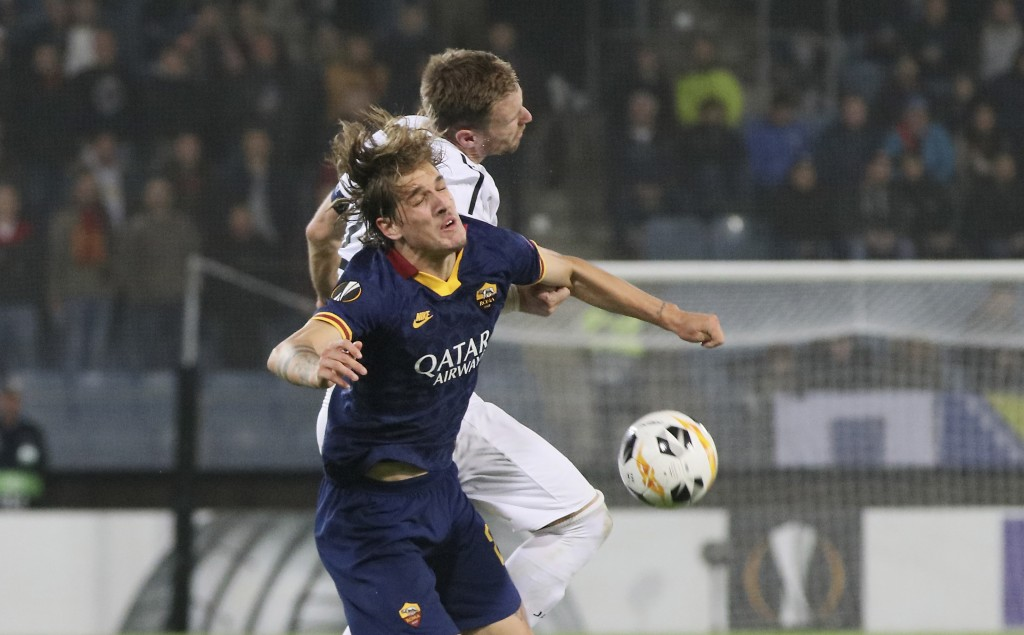 Roma's Nicolo Zaniolo, foreground, jumps for the ball with Wolfsberger's Michael Sollbauer during the Europa League group J soccer match between Wolfs