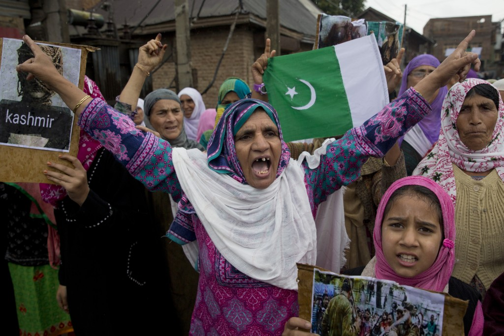 Kashmiris shout slogans during a protest after Friday prayers against the abrogation of article 370, on the outskirts of Srinagar, Indian controlled K...
