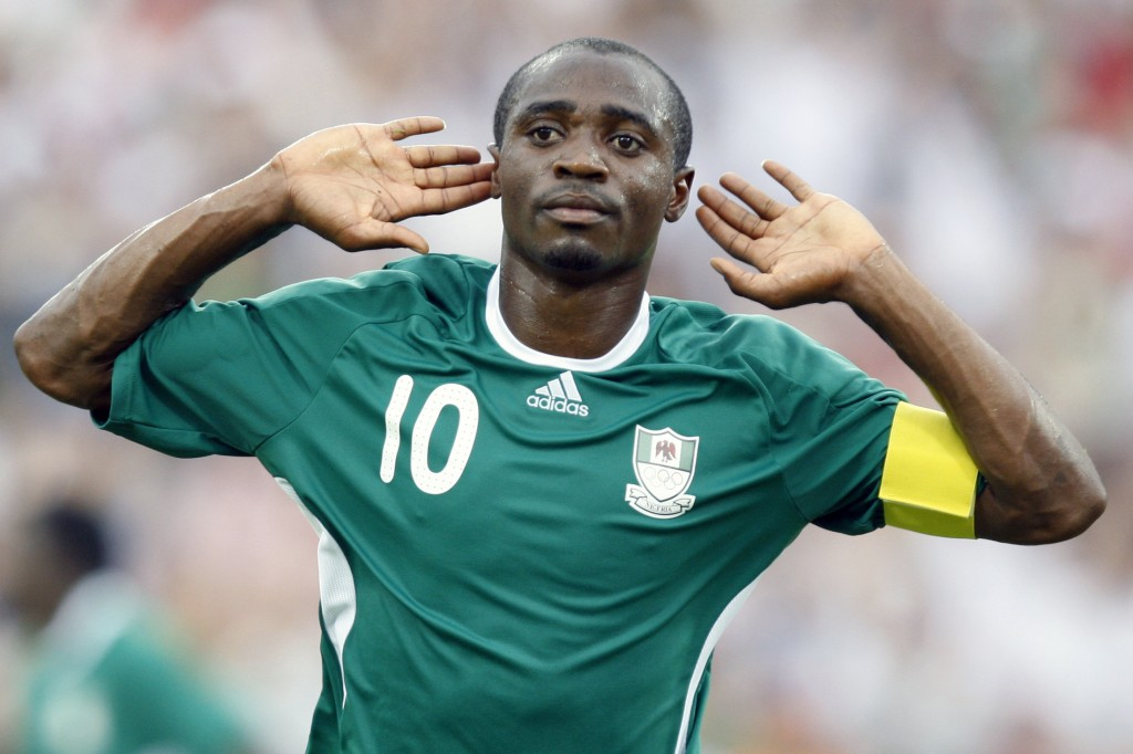 FILE - In this Aug. 13, 2008, file photo, Nigeria's Promise Isaac celebrates after scoring against the United States during a soccer match at the 2008...