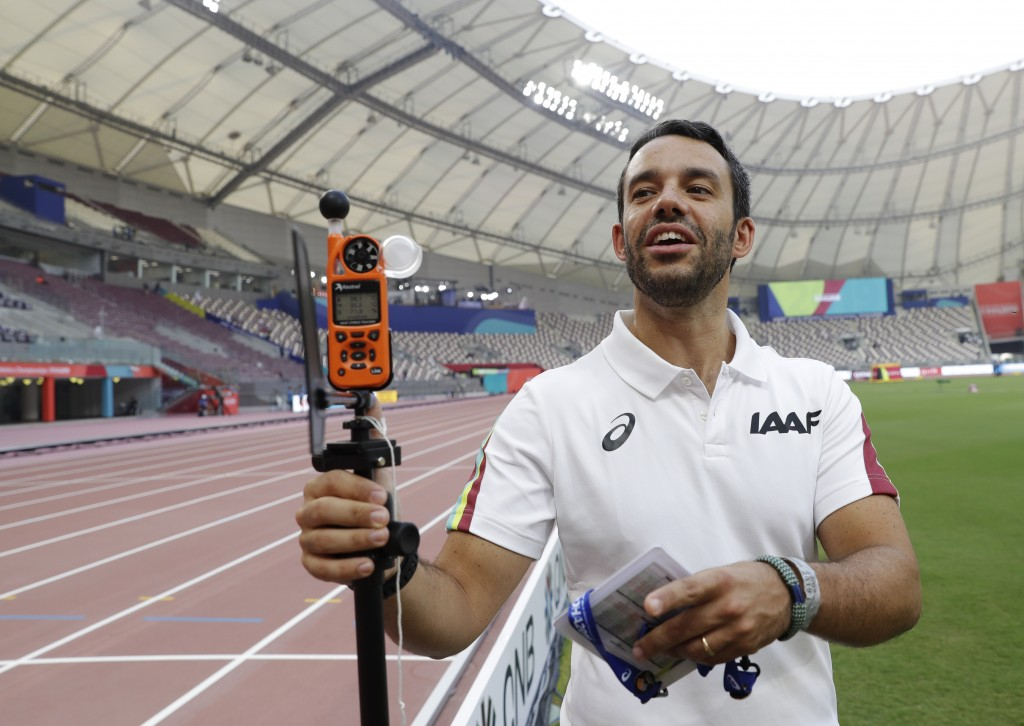 Dr. Paolo Adami explains the use of a heat measuring sensor at the World Athletics Championships in Doha, Qatar, Monday, Sept. 30, 2019. There are aro...