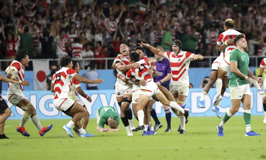 In this Saturday, Sept. 28, 2019, file photo, Japan's players celebrate after defeating Ireland 19-12 in their Rugby World Cup Pool A game at Shizuoka...