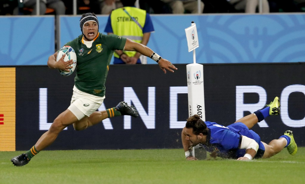 South Africa's Cheslin Kolbe runs past an Italian defender to score a try during the Rugby World Cup Pool B game at Shizuoka Stadium Ecopa between Sou...