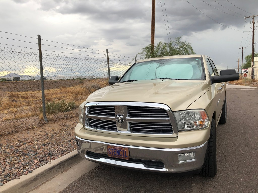 The vehicle of former priest Steven Stencil, left, is parked outside a bus company in Phoenix, Ariz., on Thursday, Sept. 26, 2019. In 2001, Stencil wa...