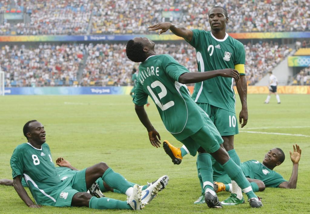 FILE - In this Aug. 13, 2008, file photo, Nigeria's Promise Isaac (10) celebrates with teammates Kaita Sani, left, Ebenezer Ajilore and Solomon Okoron...