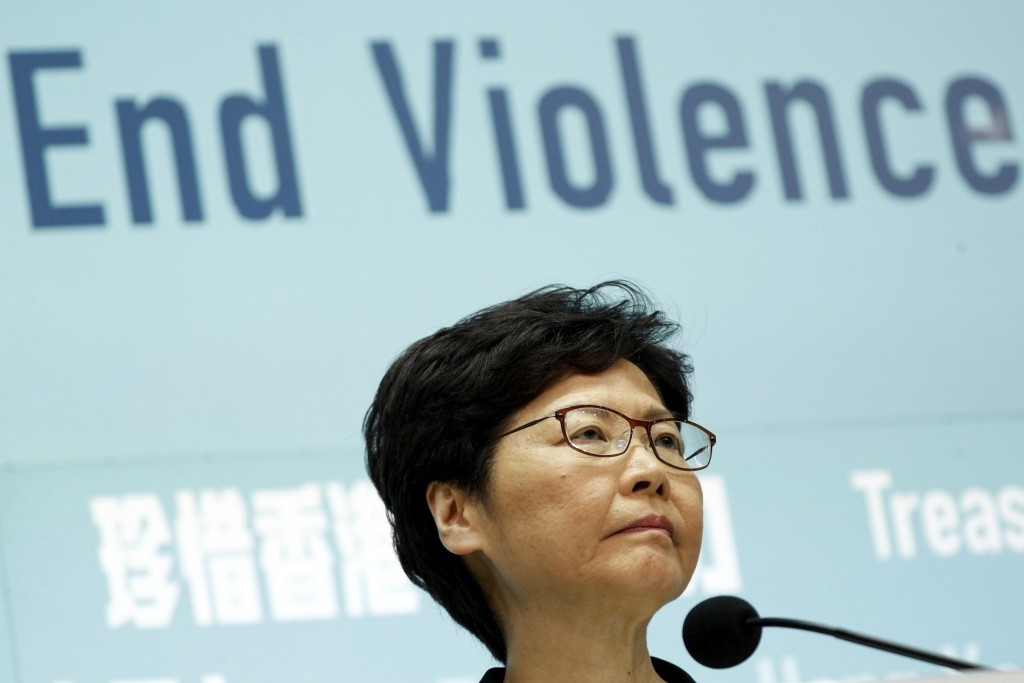 Hong Kong Chief Executive Carrie Lam attends a press conference in Hong Kong Friday, Oct. 4, 2019. The Hong Kong leader has banned protesters from wea