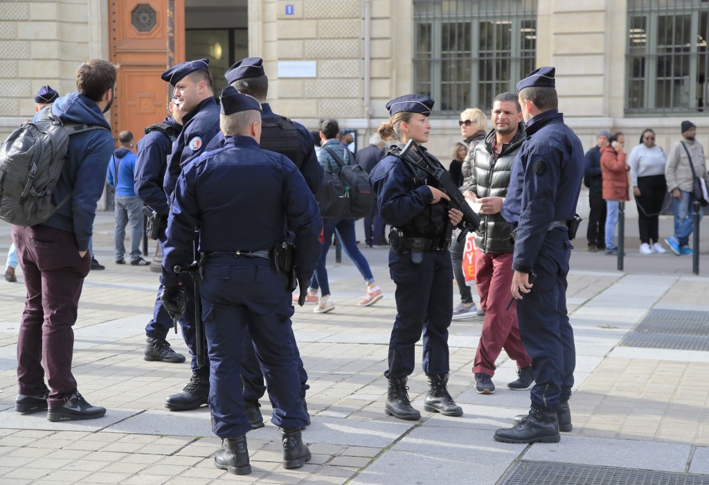 Police officers patrol outside the police headquarters in Paris, Friday, Oct. 4, 2019. The French government says there is nothing to suggest the poli...