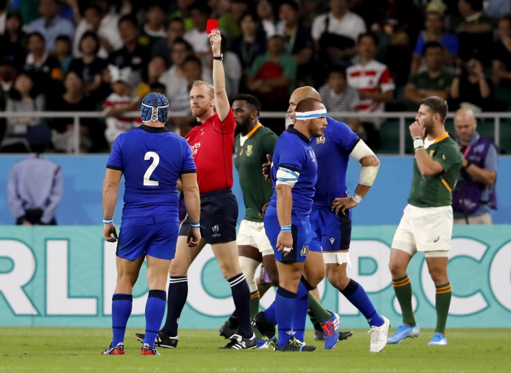 Referee Wayne Barnes shows a red card to Italy's Andrea Lovotti, right, during the Rugby World Cup Pool B game at Shizuoka Stadium Ecopa between South...