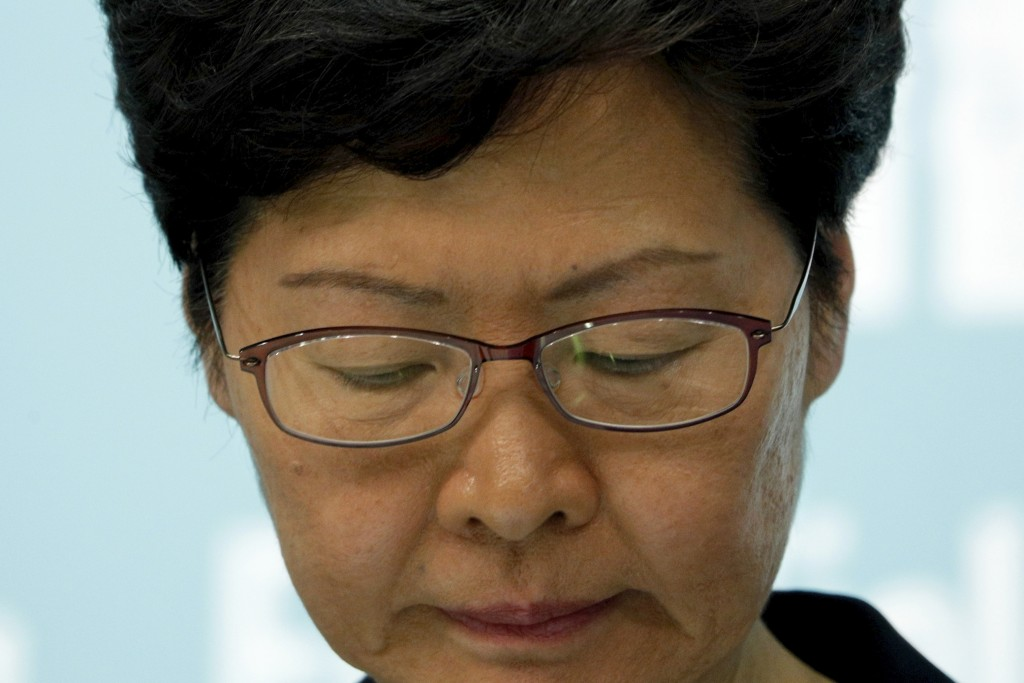 Hong Kong Chief Executive Carrie Lam reacts during a press conference in Hong Kong Friday, Oct. 4, 2019. The Hong Kong leader has banned protesters fr...