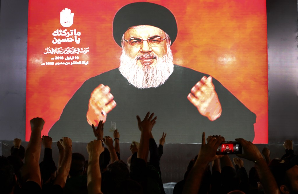 FILE - In this Sept. 19, 2018 file photo, Hezbollah leader Sheik Hassan Nasrallah speaks via a video link, during activities commemorating the death o...