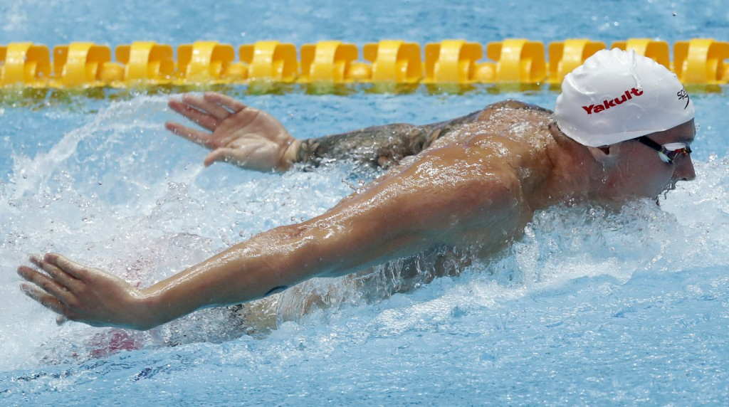 FILE - In this July 26, 2019, file photo, United States' Caeleb Dressel swims in the 100m butterfly at the World Swimming Championships in Gwangju, So