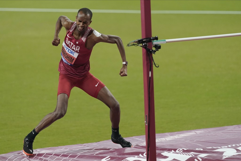 Mutaz Essa Barshim, of Qatar, celebrates after a jump during the men's high jump final at the World Athletics Championships in Doha, Qatar, Friday, Oc...