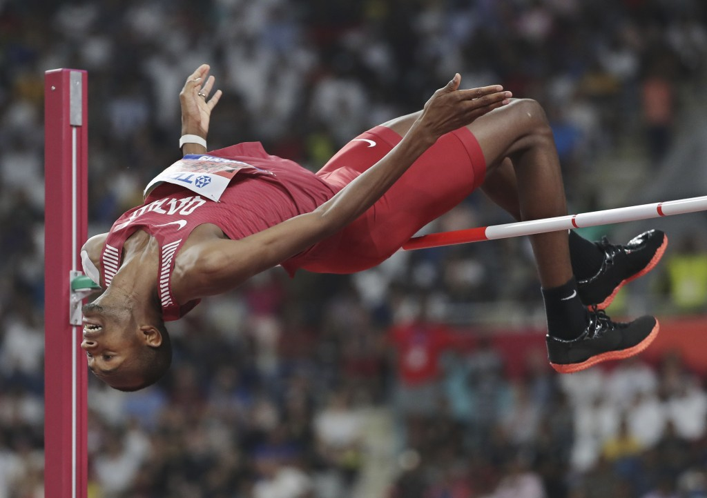 Mutaz Essa Barshim, of Qatar, competes in the men's high jump final at the World Athletics Championships in Doha, Qatar, Friday, Oct. 4, 2019. Barshim
