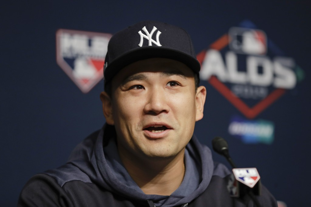 New York Yankees starting pitcher Masahiro Tanaka, of Japan, speaks during a news conference before Game 1 of an American League Division Series again...