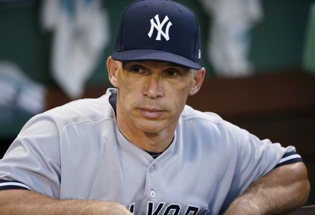 FILE - In this July 16, 2017, New York Yankees manager Joe Girardi stands in the dugout before the second game of the baseball team's doubleheader aga...