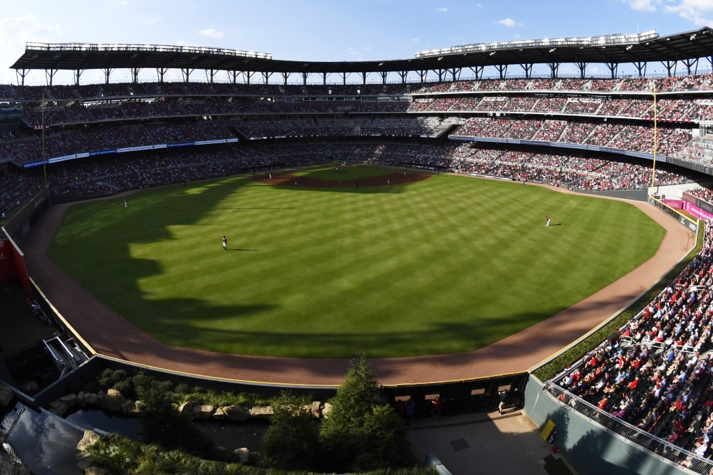 The Atlanta Braves play the St. Louis Cardinals in the fourth inning during Game 2 of a best-of-five National League Division Series, Friday, Oct. 4, ...