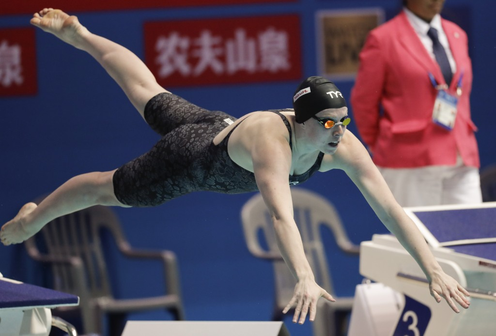FILE - In this July 28, 2019, file photo, United States' Lilly King starts in the women's 50m breaststroke final at the World Swimming Championships i...