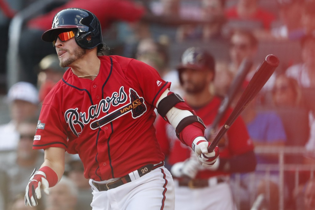 Atlanta Braves third baseman Josh Donaldson (20) follows through after hiting an RBI single against the St. Louis Cardinals in the first inning during...