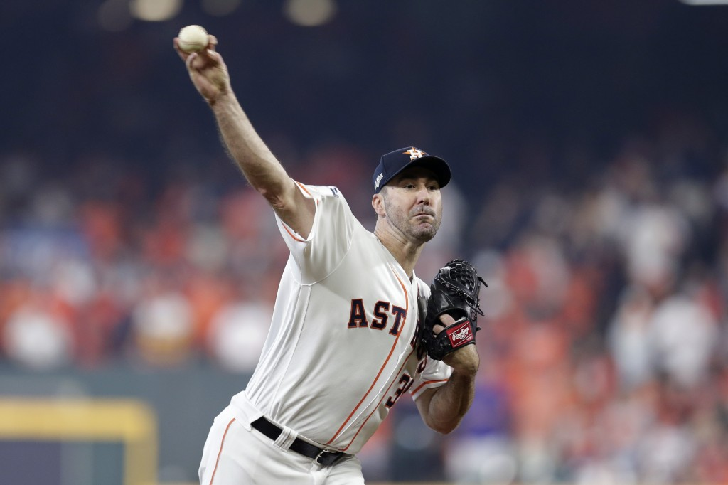 Houston Astros starting pitcher Justin Verlander (35) delivers a pitch against the Tampa Bay Rays in the first inning during Game 1 of a best-of-five ...