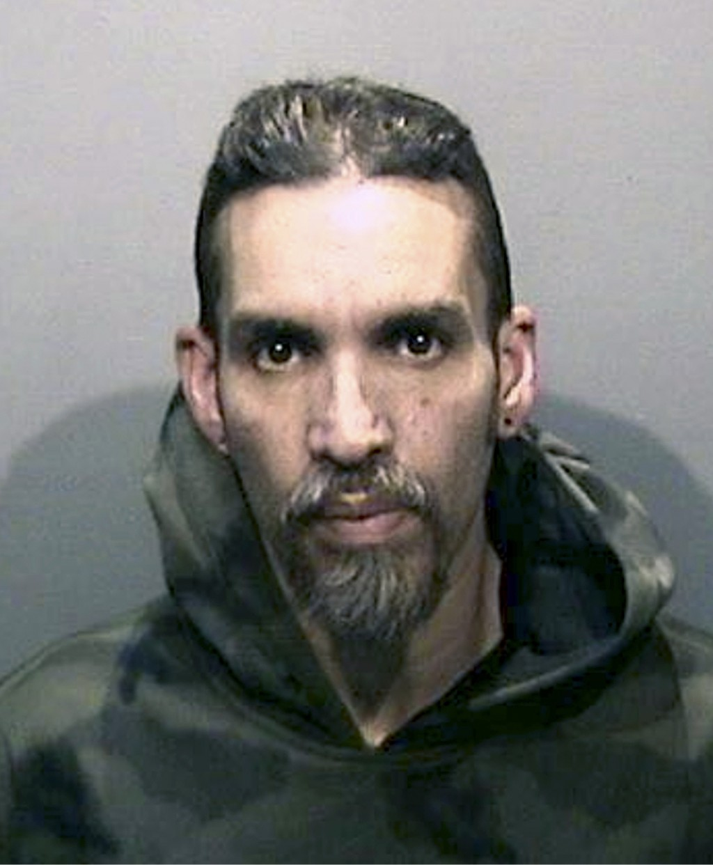 FILE - This Monday, June 5, 2017, file photo released by the Alameda County Sheriff's Office shows Derick Almena at Santa Rita Jail in Alameda County,