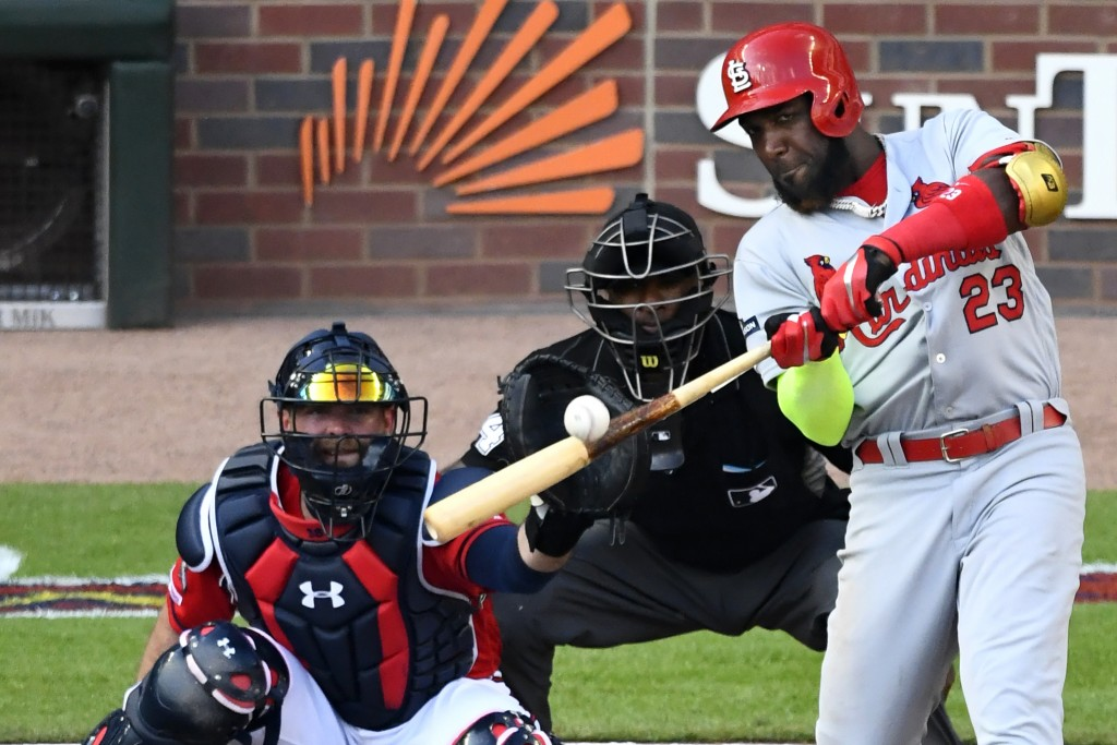 St. Louis Cardinals left fielder Marcell Ozuna (23) hits a single against the Atlanta Braves in the fourth inning during Game 2 of a best-of-five Nati...