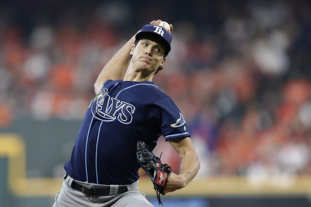 Tampa Bay Rays starting pitcher Tyler Glasnow (20) delivers a pitch against the Houston Astros in the first inning during Game 1 of a best-of-five Ame...