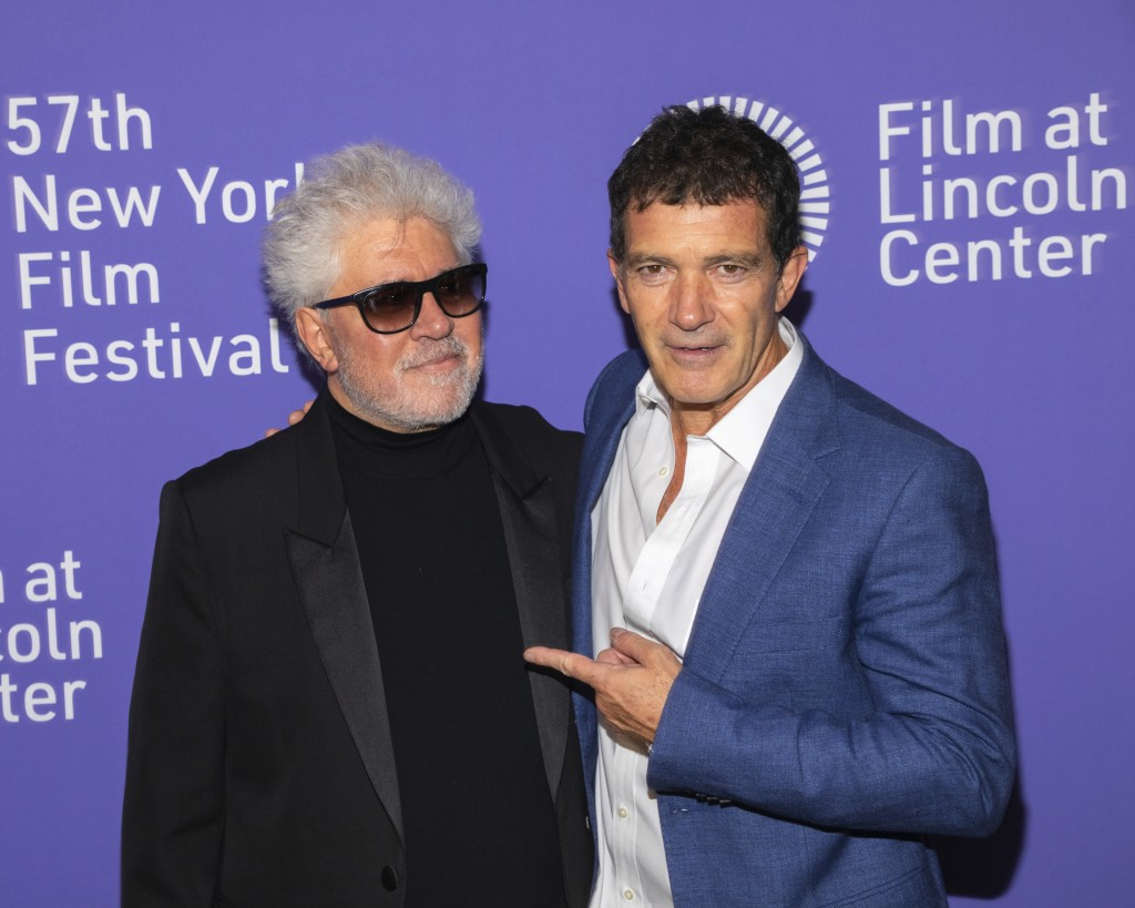 """FILE - This Sept. 28, 2019 file photo shows actor Antonio Banderas, right, and director/screenwriter Pedro Almodovar at the premiere of """"Pain and Glor"""