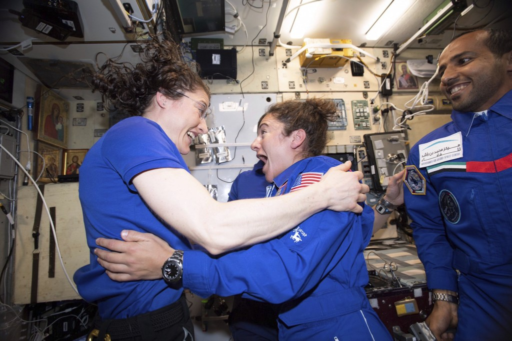 In this photo made available by NASA astronaut Jessica Meir on Sept. 29, 2019, Christina H. Koch, left, and Meir greet each other after Meir's arrival
